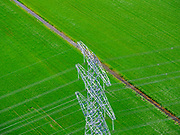 Nederland, Drenthe, Emmen, 07-05-2021; hoogspanningsmast en groene akker in het voorjaar, 'groene stroom' - direct ten westen van Emmen.<br /> <br /> luchtfoto (toeslag op standard tarieven);<br /> aerial photo (additional fee required)<br /> copyright © 2021 foto/photo Siebe Swart