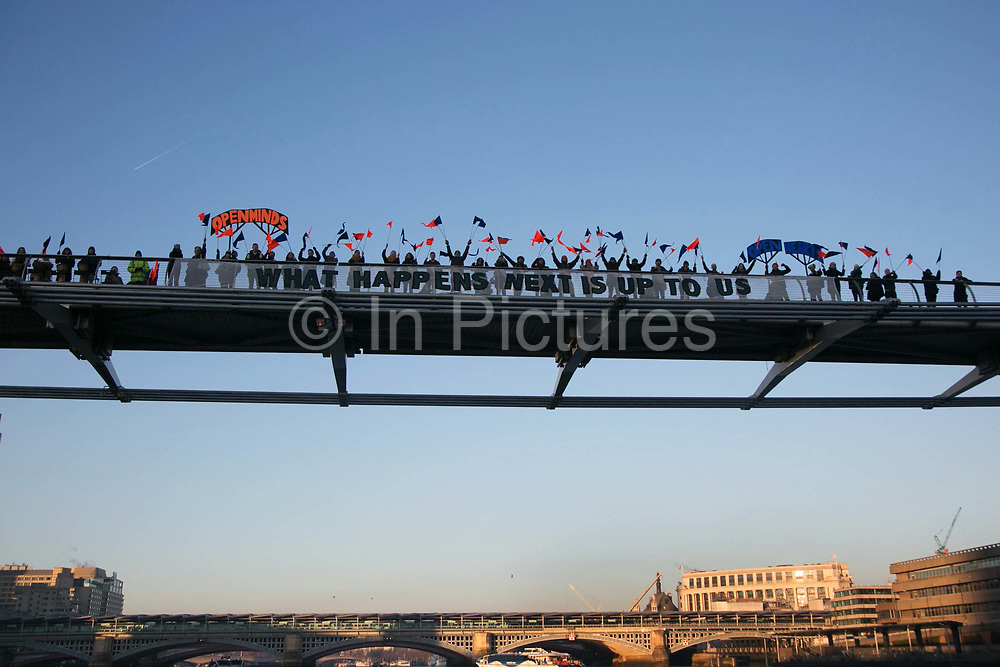Banners were dropped on bridges crossing the Thames in protest against the inauguration of Donald Trump, January 21st 2017 in London. A banner on the Millenium Bridge. On Friday 20th January over 50 groups across the United Kingdom dropped banners from bridges as an act of defiance against Trump's inauguration. The groups, who form the 'Bridges not Walls' movement, staged their demonstration to show support for people in the USA and beyond fearing the consequences of Trump's election. <br /> <br /> In London ten iconic bridges on the Thames saw huge banners 25m long unfurled on them.