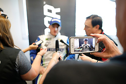 March 1, 2019 - Las Vegas, NV, U.S. - LAS VEGAS, NV - MARCH 01: A reporter records an interview with a smart phone as Ty Dillon (13) Germain Racing Chevrolet Camaro ZL1 answers questions from the media in the ThriveHive Digital Center prior to practice and qualifying for the Monster Energy NASCAR Cup Series Pennzoil 400 on March 1, 2019, at Las Vegas Motor Speedway in Las Vegas, NV. (Photo by Joe Buglewicz/Icon Sportswire) (Credit Image: © Joe Buglewicz/Icon SMI via ZUMA Press)