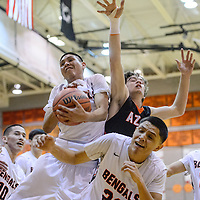 Gallup Bengal Matthew Begay (33) fights a rebound away from Aztec Tiger Lindsey Larabee (3) Friday at Gallup High School.