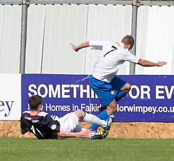 Morton's Joseph McKee injured in this tackle by Falkirk's Conor McGrandles.<br /> half time : Falkirk 2 v 0 Morton, Scottish Championship 17/8/2013.<br /> ©Michael Schofield.