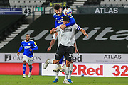 Cardiff City forward Kieffer Moore (10) outjumps Curtis Davis of Derby County (33) to head the ball  during the EFL Sky Bet Championship match between Derby County and Cardiff City at the Pride Park, Derby, England on 28 October 2020.