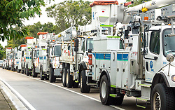 October 10, 2018 - Juipter, Florida, U.S. - FPL crews leave a Jupiter substation Wednesday morning, headed to North Florida to help restore power after Category 4 Hurricane Michael hits the area.  The ten 2-3 person crews will join more than 1,300 crews from across Florida staging in Lake City, Daytona Beach and Sarasota. (Credit Image: © Lannis Waters/The Palm Beach Post via ZUMA Wire)