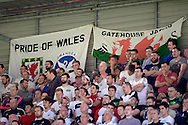 Swansea City fans watching the game with banners being hung during the match. Barclays Premier League, Watford v Swansea city at Vicarage Road in London on Saturday 12th September 2015.<br /> pic by John Patrick Fletcher, Andrew Orchard sports photography.