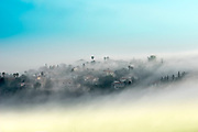 mountainous rural village in mist. Photographed on the Carmel Mountain, Israel