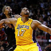19 January 2012: Los Angeles Lakers center Andrew Bynum (17) vies for the rebound with Miami Heat power forward Chris Bosh (1) during the Miami Heat 98-87 victory over the Los Angeles Lakers at the AmericanAirlines Arena, Miami, Florida, USA.