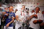 France's Steeve Guenot (center) splashes champagne while his coach Patrice Mourier (left), 1987 greco-roman wrestling world champion, cheers the crowd, at the medallists' party in Club France, in Beijing, China, on August 13, 2008. Steeve Guenot won the Olympics gold medal in the 66 kilogram greco-roman wrestling competition, while his brother Christophe Guenot (on his left) won the Olympics bronze medal in the 74 kilogram greco-roman wrestling competition. Photo by Lucas Schifres/Pictobank/Cameleon/ABACAPRESS.COM
