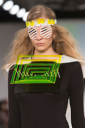 © Licensed to London News Pictures. 30/05/2015. London, UK. A model walks the runway during the Ravensbourne fashion show at Graduate Fashion Week 2015 wearing the collection of graduate student Tatjana Viethen. Graduate Fashion Week takes place from 30 May to 2 June 2015 at the Old Truman Brewery, Brick Lane. Photo credit : Bettina Strenske/LNP
