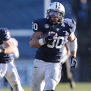 Yale running back Tyler Varga, (right), in action during the Yale Vs Princeton, Ivy League College Football match at Yale Bowl, New Haven, Connecticut, USA. 15th November 2014. Photo Tim Clayton