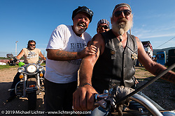 Carl's Cycle's Carl Olsen with his friends Peggy McStott and Randy Elletson on his 1965 electroglide at the Spirit of Sturgis races at the fairgrounds during the Sturgis Black Hills Motorcycle Rally. Sturgis, SD, USA. Monday, August 5, 2019. Photography ©2019 Michael Lichter.