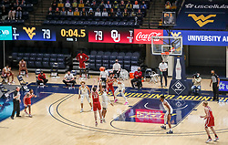 Feb 13, 2021; Morgantown, West Virginia, USA; Oklahoma Sooners guard Austin Reaves (12) misses a game winning three pointer at the end of the first overtime against the West Virginia Mountaineers at WVU Coliseum. Mandatory Credit: Ben Queen-USA TODAY Sports