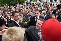 12 MAY 2004, LUDWIGSFELDE/GERMANY:<br /> Gerhard Schroeder, SPD, Bundeskanzler, schuettelt - umgeben von Personenschuetzern des BKA - Schuelern die Hand, waehrend einem spontanen Rundgang ueber den Schulhof, Besuch der Gesamtschule Ludwigsfelde<br /> Gerhard Schroeder, Federal Chancellor, is visiting a school near Berlin<br /> IMAGE: 20040512-02-024<br /> KEYWORDS: Gerhard Schröder, Schule, Schüler, pupil, pupils, Personenschützer, BKA