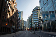 Bishopsgate in the financial distrcit / square mile. March 24th 2020 was the first day of enforced lockdown in the UK, in order to stop the spread of the Coronavirus Covid 19. On what would normally be a bustling business / week day in London, the city was deserted, with just a few people in masks out on the street, plus a few taxis and mostly empty buses.