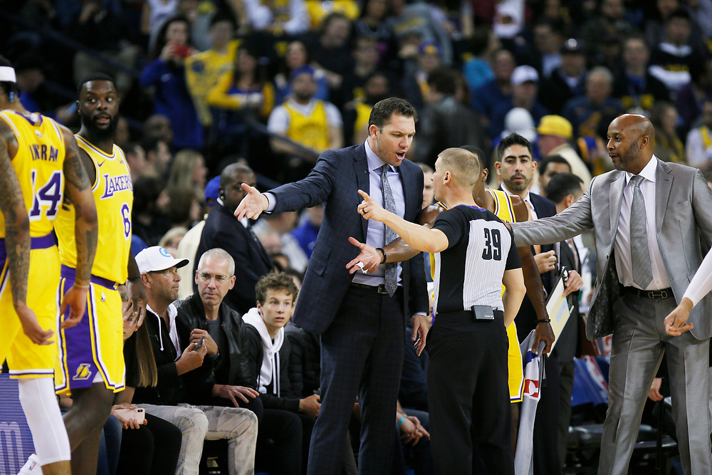 Los Angeles Lakers head coach Luke Walton talks to an official in the first half of an NBA game against the Golden State Warriors at Oracle Arena on Saturday, Feb. 2, 2019, in Oakland, Calif.