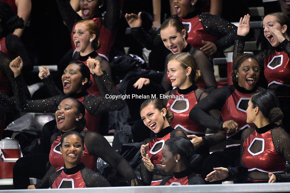 The Lake Mary dancers cheer in the stands during the first half of a high school football game against Orange City University in Lake Mary, Fla., Friday, Oct. 31, 2014. (Photo by Phelan M. Ebenhack)