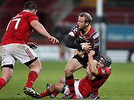 Sarel Pretorius of the Newport Gwent Dragons is held back by Duncan Williams of Munster.<br /> Guinness Pro12 rugby match, Munster v Newport Gwent Dragons at Thomond Park in Limerick , Ireland on Saturday 5th March 2016.<br /> pic by  John Halas, Andrew Orchard sports photography.