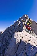Climbers on the northeast ridge of  Bear Creek Spire, John Muir Wilderness, Sierra Nevada Mountains, California