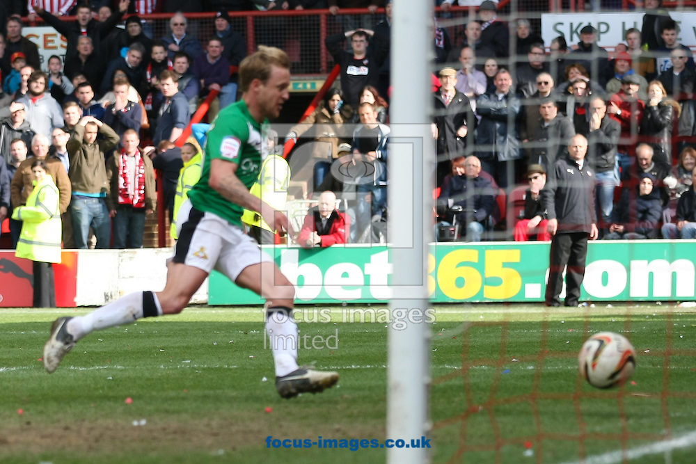 Picture by David Horn/Focus Images Ltd +44 7545 970036.27/04/2013.James Coppingger of Doncaster Rovers scores to secure the nPower League 1 Championship during the npower League 1 match at Griffin Park, London.