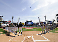 CHICAGO - APRIL 5:  Members of the Chicago White Sox and Cleveland Indians lineup for the National Anthem as jets fly overhead prior to the game at on April 5, 2010 a U.S. Cellular Field in Chicago, Illinois.  The White Sox defeated the Indians 6-0.  (Photo by Ron Vesely)