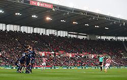 Stoke City's Xherdan Shaqiri (right) free kick hits the bar