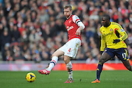 Arsenal Per Mertesacker and Sunderland's Jozy Altidore during Barclays Premier League , Arsenal v Sunderland at the Emirates Stadium in London, England on Saturday 22nd Feb 2014.<br /> pic by John Fletcher, Andrew Orchard sports photography.