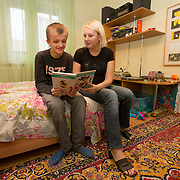 CAPTION: Dima enjoys having his mother Olga read to him, and especially appreciates the pictures in the books she chooses. However, because he is hyperactive, he is unable to focus his attention on a story for very long. NAMES MUST BE CHANGED. LOCATION: St Petersburg, Russia. INDIVIDUAL(S) PHOTOGRAPHED: Nikolay Grigoryev (son) and Olga Grigoryeva (mother).