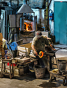Glassmith working, Venetian island of Murano, Italy. Famous for it's many furnaces and hand made glass.