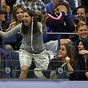 Fans react watching Novak Djokovic, Serbia, in action against Roger Federer, Switzerland, in the Men's Singles Final during the US Open Tennis Tournament, Flushing, New York, USA. 13th September 2015. Photo Tim Clayton