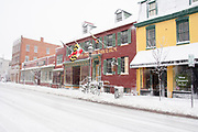 Bright shopfronts during blizzard in Annapolis, Maryland