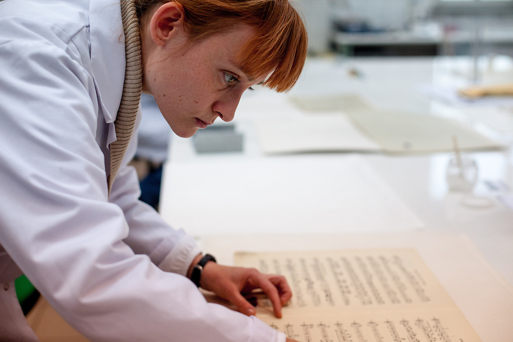 Employee Nel Jastrzebiowska, working since 12 Years in the lab, at the Auschwitz  Museum Preservation lab for documents, books and other historical papers. At the moment the employees work on note sheets of composer Tchaikovsky which had been lately found and were used by the prisoners orchestra in Auschwitz. The Museum Preservation Department is responsible for protecting everything that remains at the Auschwitz-Birkenau Concentration Camp site.