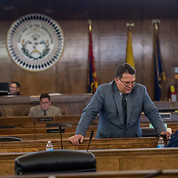 Council delegate Dwight  Witherspoon awaits the start of  the Naabik'íyáti' special meeting at the Navajo Nation Council chambers in Window Rock Wednesday.