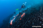 diver Bud Turpin and erupting pillow lava at underwater eruption of Kilauea Volcano, Hawaii Island ( the Big Island ) Hawaii, U.S.A. ( Central Pacific Ocean ) MR 381