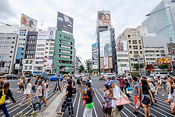 Busy pedestrian crossing at fashionable Omotesando district in Tokyo Japan