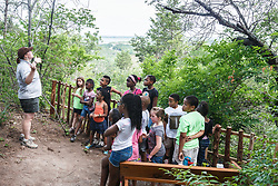 Camp leader teaching kids, Dogwood Canyon Audubon Center, Cedar Hill, Texas, USA.