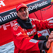 Leg 11, from Gothenburg to The Hague, day 01 on board MAPFRE, Blair Tuke moving a sail while looking at Dongfeng. 21 June, 2018.