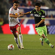 Tim Cahill, (left), New York Red Bulls, challenged by Marco Pappa, Seattle Sounder, during the New York Red Bulls Vs Seattle Sounders, Major League Soccer regular season match at Red Bull Arena, Harrison, New Jersey. USA. 20th September 2014. Photo Tim Clayton