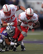 Nebraska running back Brandon Jackson (32) gets dragged down from behind by Kansas State safety Kyle Williams (9) at Bill Snyder Family Stadium in Manhattan, Kansas, October 14, 2006.  The Huskers beat the Wildcats 21-3.<br />