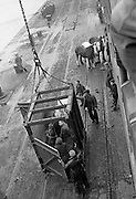 16/01/1960<br /> 01/16/1960<br /> 16 January 1960<br /> Horses for slaughter being loaded for export to the Netherlands from Dublin. A view of the box attached to the crane to load horses onto the ship.