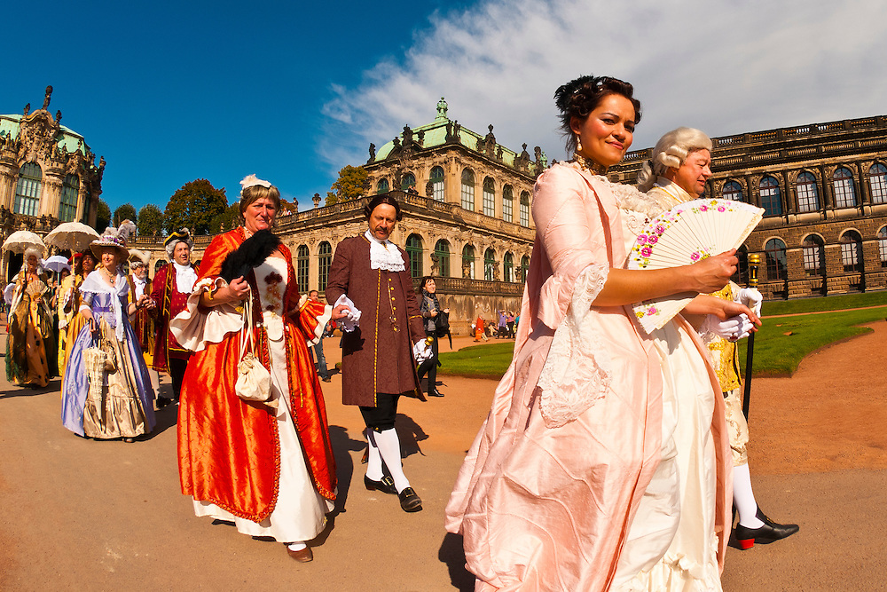 A procession of the Royal Court of August the Strong (people in historical costume) at the Dresden Zwinger, Dresden, Saxony, Germany