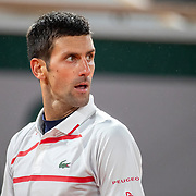 PARIS, FRANCE October 07.  Novak Djokovic of Serbia reacts during his match against Pablo Carreno Busta of Spain in the Quarter Finals of the singles competition on Court Philippe-Chatrier during the French Open Tennis Tournament at Roland Garros on October 7th 2020 in Paris, France. (Photo by Tim Clayton/Corbis via Getty Images)