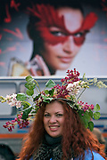 Moscow, Russia, 13/03/2005..A Russian woman in parade fancy dress with an advertising billboard behind for Valentino cosmetics. Many Russian cities, and in particular Moscow, are plastered with foreign advertsing which contrasts with the surrounding Soviet era settings.