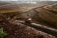 A ore truck moves iron ore from an open pit iron ore mine in the Pilbara, Western Australia.
