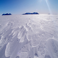 ANTARCTICA, Thiel Mountains and wind-carved sastrugi on polar ice cap 300 miles from South Pole.