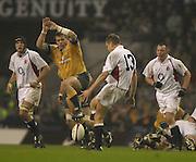 Twickenham, England, Autumn International. RFU Twickenham Stadium<br /> 16/11/2002<br /> International Rugby - England vs Australia.<br /> Will Greenwood chips the ball past the charging Australian team.         [Mandatory Credit:Peter SPURRIER/Intersport Images]