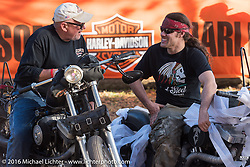 Brad Gregorry chats with another bike show entrant at Harley Davidson's Editor's Choice Bike Show at the Broken Spoke Saloon during Daytona Bike Week 75th Anniversary event. FL, USA. Wednesday March 9, 2016.  Photography ©2016 Michael Lichter.