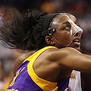 Sisters Chiney Ogwumike, (behind), Connecticut Sun and Nneka Ogwumike, Los Angeles Sparks, (wearing face mask), playing against each other for the fist time in the WNBA during the Connecticut Sun Vs Los Angeles Sparks WNBA regular season game at Mohegan Sun Arena, Uncasville, Connecticut, USA. 3rd July 2014. Photo Tim Clayton