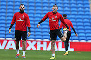 Gareth Bale of Wales ® and Joe Ledley of Wales (l) stretch during the Wales football team training at the Cardiff city Stadium in Cardiff , South Wales on Friday 1st September 2017.  the team are preparing for their FIFA World Cup qualifier home to Austria tomorrow.  pic by Andrew Orchard, Andrew Orchard sports photography