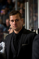 KELOWNA, CANADA - JANUARY 19: Kelowna Rockets' assistant coach Adam Brown stands on the bench against the Prince Albert Raiders  on January 19, 2019 at Prospera Place in Kelowna, British Columbia, Canada.  (Photo by Marissa Baecker/Shoot the Breeze)