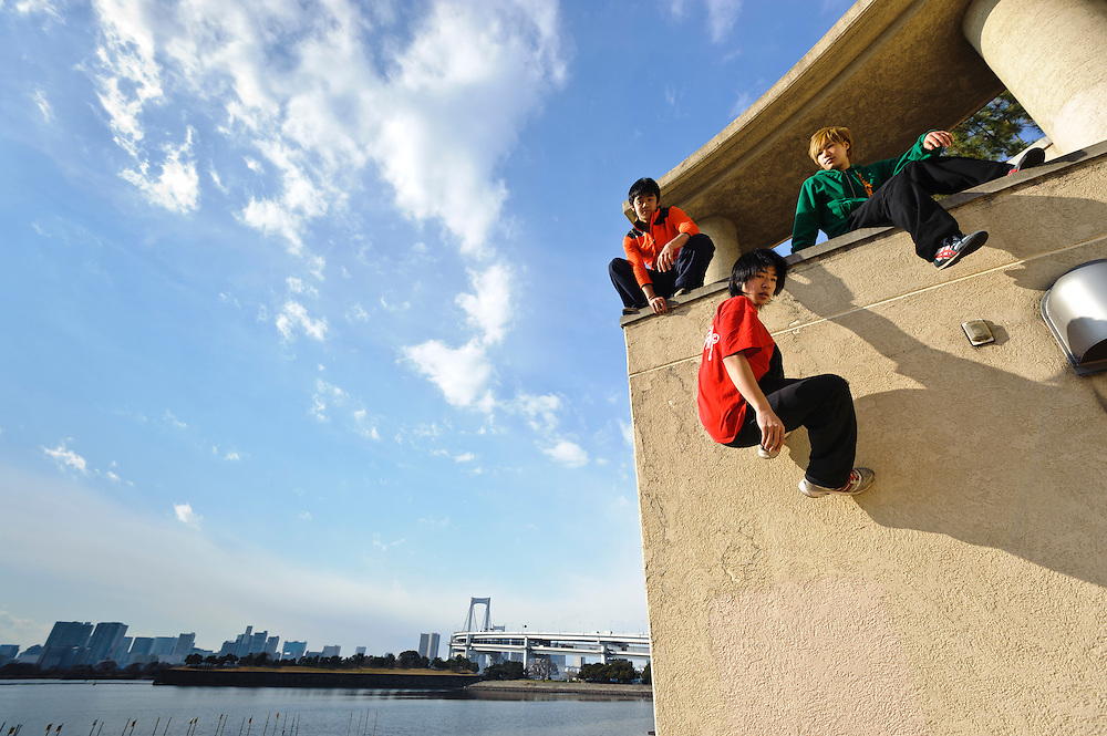 """(L to R) Traceurs (Parkour practitioners) Jun """"Sullivan"""" Sato, """"Yutaro"""" and """"Zen"""". Practicing Parkour in Odaiba, Tokyo, Japan, January 27, 2012. Parkour is a modern method of physical training, also known as freerunning. It was founded in France in the 1990s. There is a small group of around 50 parkour practitioners in Tokyo."""