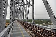 Riding the span down as a train approaches the Cape Cod Canal railroad bridge.